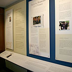 Exhibit design, panel detail with framed book presentation