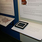 Exhibit design, panel detail with digital photo frame inset